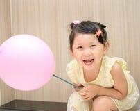 Girl take a balloon Stock Photos