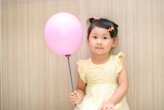 Girl take a balloon Royalty Free Stock Images