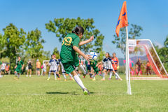 A girl are take a corner kick Royalty Free Stock Images
