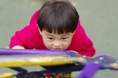 Girl take exercise. A chinese girl cliambing the ladder Royalty Free Stock Images