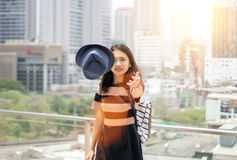 Girl take of her hat fighting sunlight Royalty Free Stock Image