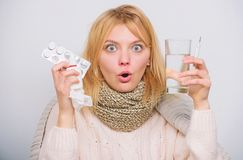 Girl take medicine to break fever. Breaking fever concept. Headache and fever remedies. Woman sick person hold glass stock images