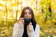 Girl take photo with camera Royalty Free Stock Image
