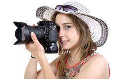 Girl take a photo with digital camera Stock Images