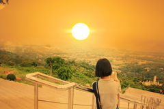 Girl take photo sunset Royalty Free Stock Image
