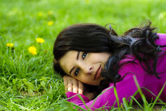 Girl take pleasure on the grass Royalty Free Stock Photography