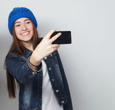 Girl take a self portrait Stock Images
