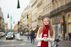Girl with taken away coffee on a street Stock Photo