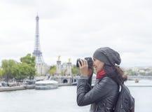 Girl taken pictures Eiffel Tower Royalty Free Stock Photos