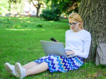 Girl takes advantage of online freelance job. Girl sit grass with notebook. Save your time with shopping online. Sales. Manager occupation benefits. Woman with stock photo