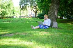 Girl takes advantage of online shopping. Save your time with shopping online. Sales manager occupation. Buy clothes. Online. Girl sit grass with notebook. Woman stock photo