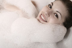 The girl takes a bath. Stock Image