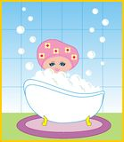 The girl takes a bath with foam Royalty Free Stock Photography