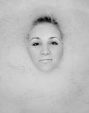 A girl takes a bath in the foam Stock Photography