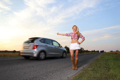 Girl takes a car Stock Photography