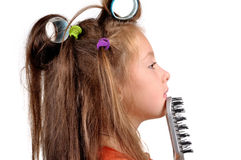 Girl takes care of the hair Royalty Free Stock Photos