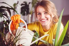 Girl Takes Care of Plants Stock Images