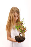Girl takes care of the tree Stock Photo