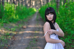 Girl takes off her dress in the woods Stock Photos