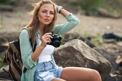 Girl takes photographs with vintage photo camera Royalty Free Stock Photography