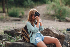 Girl takes photographs with vintage photo camera Stock Photo