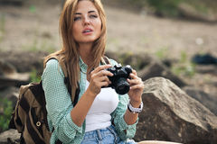 Girl takes photographs with vintage photo camera Royalty Free Stock Images