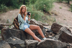 Girl takes photographs with vintage photo camera Stock Image