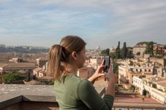 Girl takes photos in Rome royalty free stock images