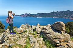 Girl takes picture of Bay Porto in Corsica Island Stock Images