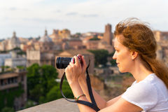 Girl takes a picture in the Roman Forum Royalty Free Stock Images