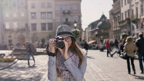 Girl Takes Picture in Street stock footage