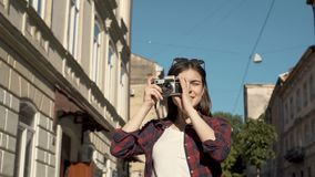 Girl takes pictures with camera stock video footage