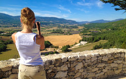 Girl takes pictures of the landscape of Provence Royalty Free Stock Image