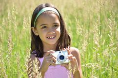 Girl Takes Pictures Outdoors Stock Photo