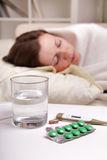 Girl takes the pill Royalty Free Stock Image