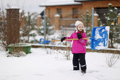A girl takes pride in completing a shoveling job Royalty Free Stock Images