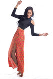 Girl takes a step leaning her body. Spontaneous. Imbalance. Afro. Woman is unbalanced, but she smiles and has fun. Full length body of brazilian girl, mixed Royalty Free Stock Photography
