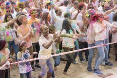Geoje, SOUTH KOREA - MARCH 2018: Holi festival. The girl takiing picture at Holi festival Stock Photos