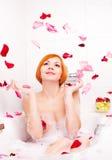 Girl taking a bath Stock Image