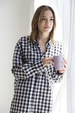 Girl taking a coffee in the morning Stock Photography