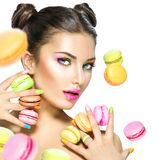 Girl taking colorful macaroons Royalty Free Stock Image