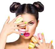 Girl taking colorful macaroons Stock Photos