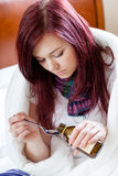 Girl taking cough syrup Stock Photography