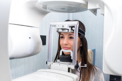 Girl taking digital 3D panoramic dental x-ray. Royalty Free Stock Photos