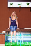 Girl taking fish pedicure treatment, rufa garra spa procedure Stock Photos