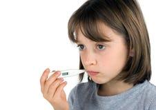 Girl taking her temperature Stock Photos