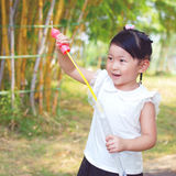 Girl taking her toy Royalty Free Stock Image