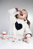 Girl taking medication Stock Photos