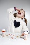Girl taking medication. Little girl taking medication by herself Stock Photos