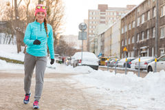 Girl taking morning walk in winter Royalty Free Stock Photography